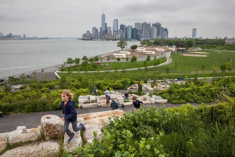 "View of Manhattan from ""The Hills,"" a new park developed on Governors Island's southern acreage."
