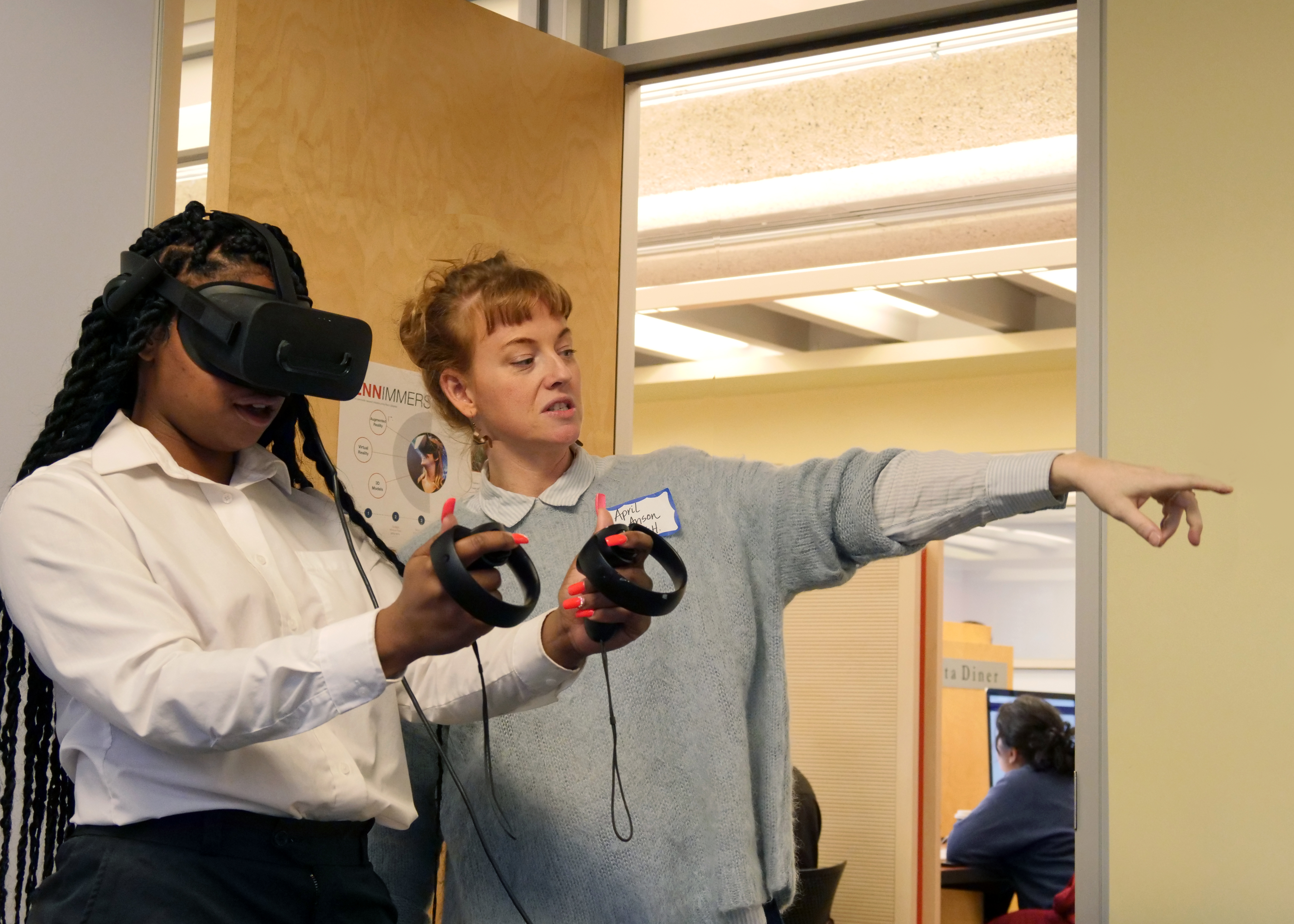 April Anson shows a participant how to use VR controls