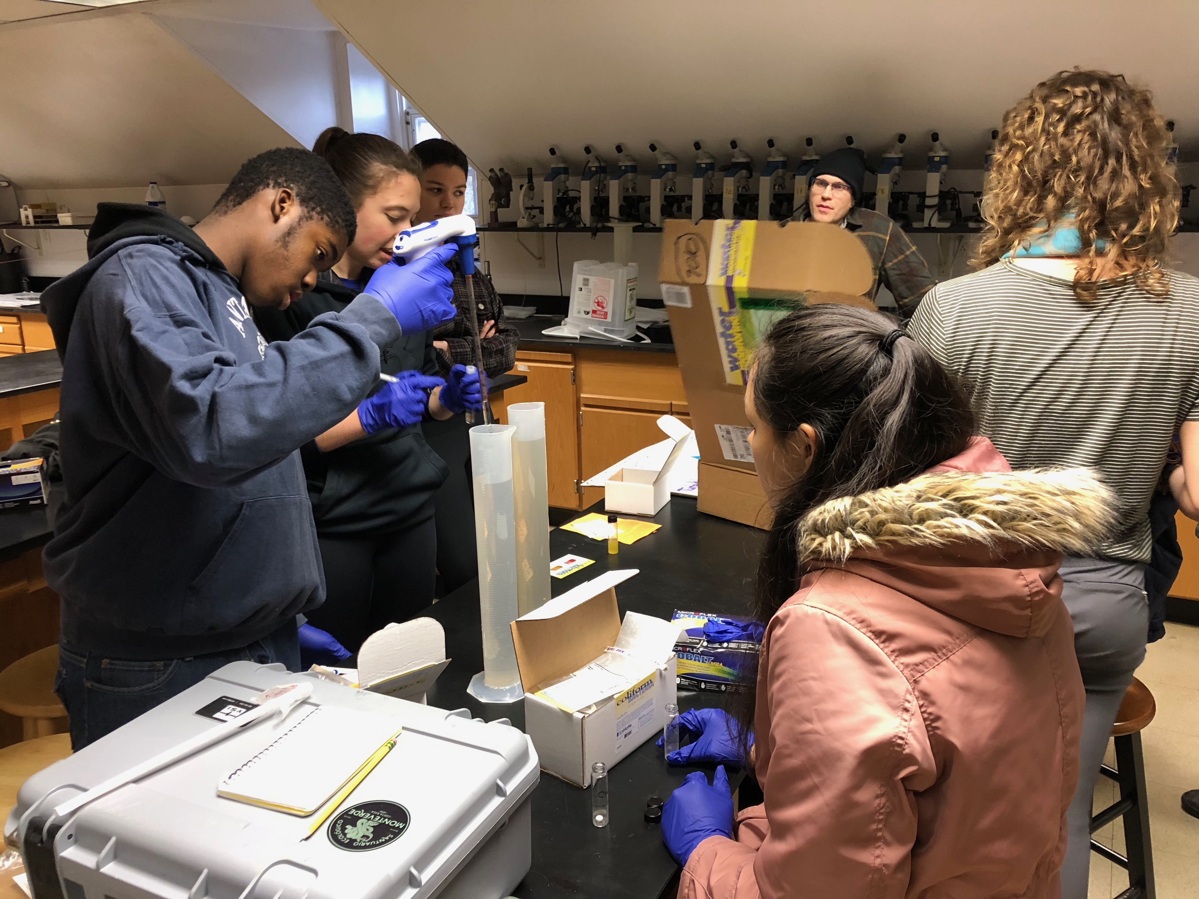 Penn undergrads and PWD Watershed Stewards conducting water quality testing at the Cobbs Creek Environmental Education Center