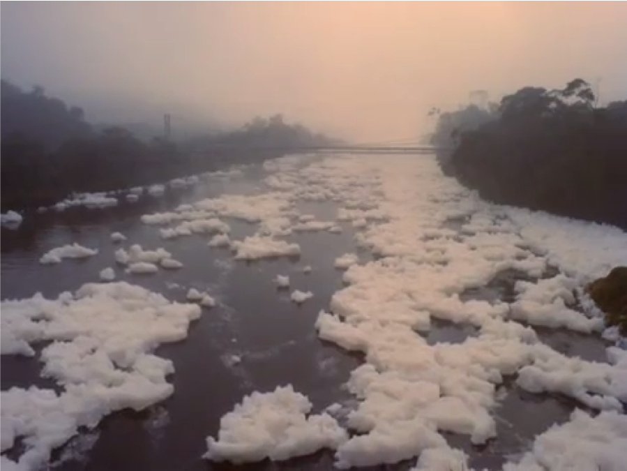 Another film still of the foam floating on the water.