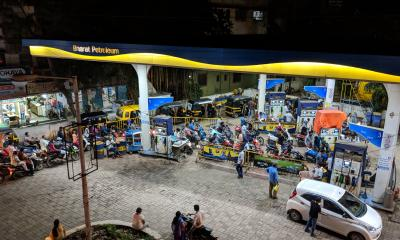 A long line for gas in India.