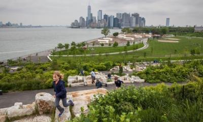 "View of Manhattan from ""The Hills,"" a new park developed on Governors Island's southern acreage. Photo © Robin Michals, 2018"