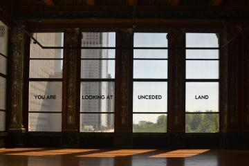 You are looking at unceded land appears in text on a series of four windows.