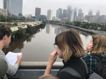 Liquid Histories and Floating Archives students looking out towards the Schuylkill from the South Street bridge