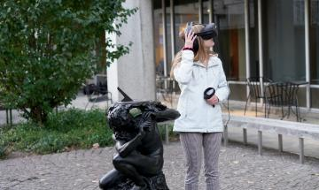VR user with headset in front of the Van Pelt Library